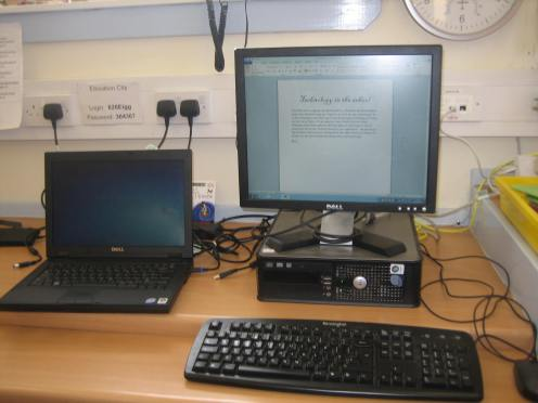 This is one of our laptops and the desktop computer. If you look carefully, you can see what I wrote for my blog post.