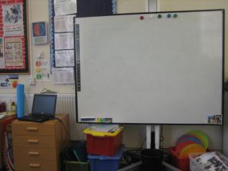 This is our whiteboard. The teacher can write on it and also use it to project pictures and films.