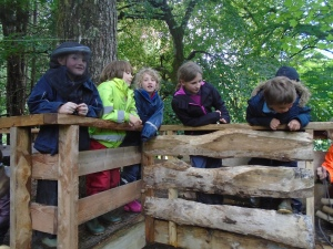 Muck and Eigg on the climbing frame in forest school
